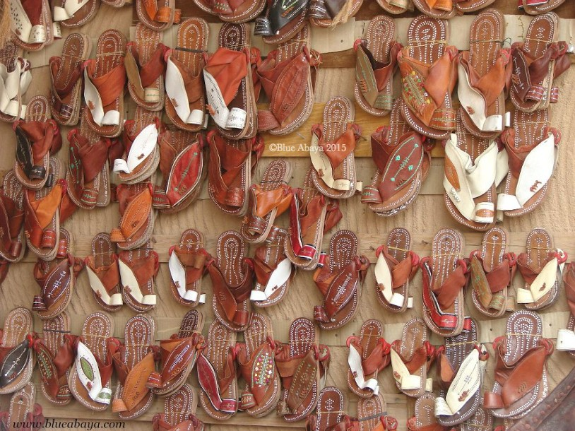 saudi leather sandals on wall